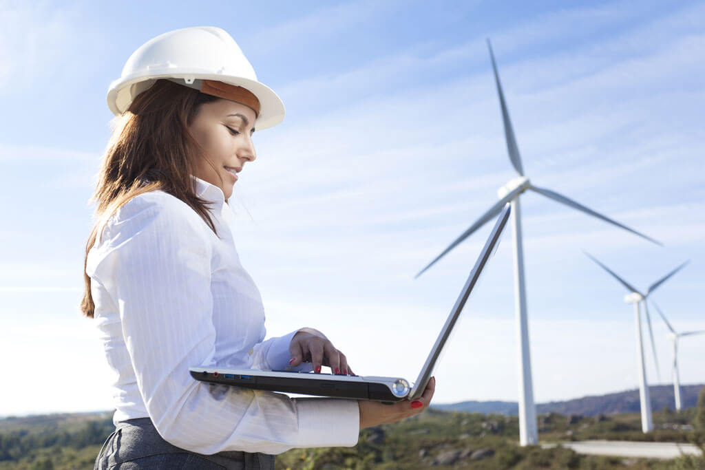 woman reading report from environmental management software