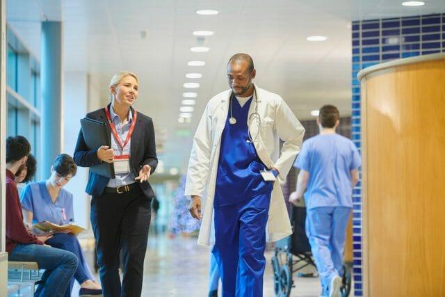 Healthcare Industries - photo of 2 doctors walking inside hospital